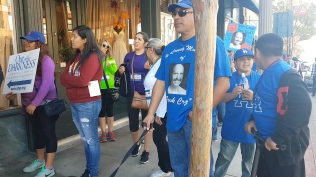 At the AFSP's Out of the Darkness Walk in Pasadena in November 2017, participants spoke of their struggle and their loss and wore beads to symbolize their connection with suicide.